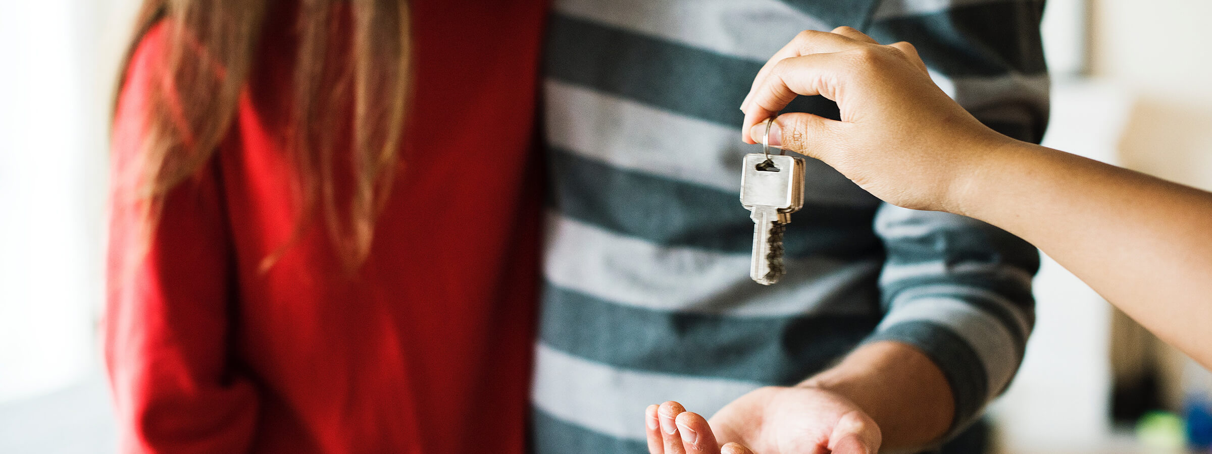 Badu-Capital-For-House-And-Land-Purchasers-Couple-Being-Handed-Keys